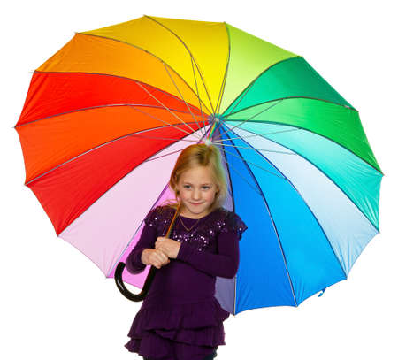 a small child with a colorful umbrella on a white background. photo