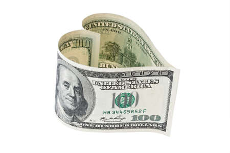 $ 100 bill into a heart shape. against a white background photo