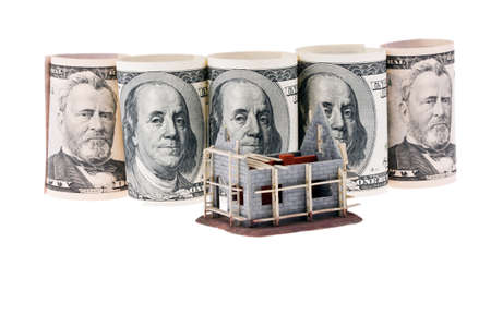modell: many dollar bills and shell house on a white background