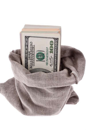 indebtedness: many dollar bills in a sack. white background