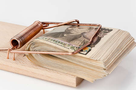 yen bills from japan in a mousetrap Stock Photo - 11854612