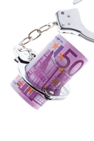 drug bust: a lot of  euro bank notes with handcuffs