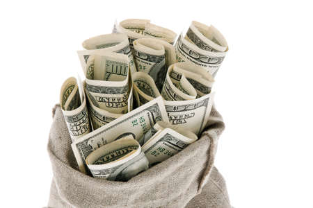 many dollar bills in a sack. white background Stock Photo - 11854515