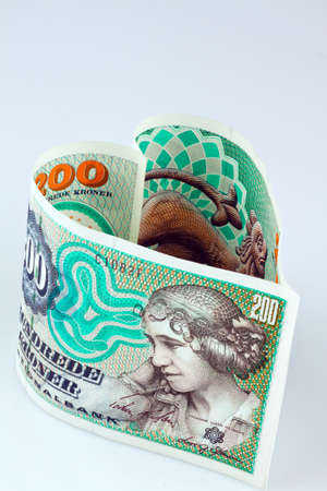 seem: danish crowns. currency from denmark in europe. in a heart shape. Stock Photo