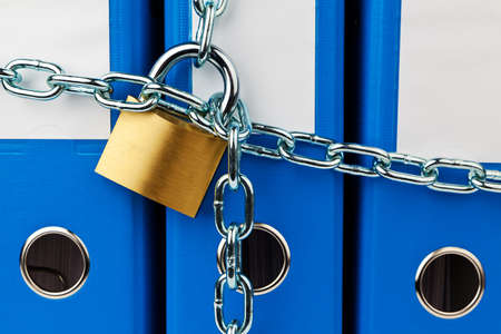 policy document: a file folder with chain and padlock closed. privacy and data security.