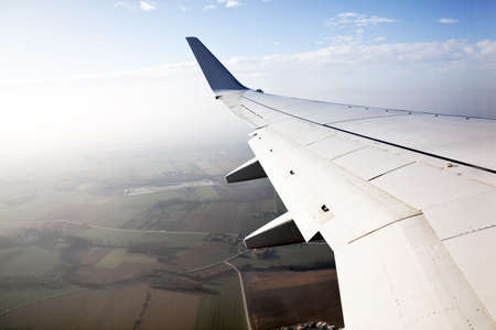 airfoil: wing of a passenger aircraft at the start Stock Photo