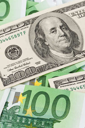parity: dollar and euro bills. euro dollar symbol differences