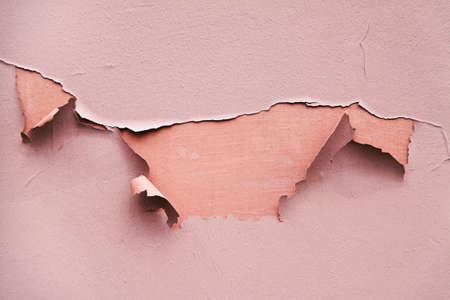 on the wall is a wallpaper is torn. motive for background Stock Photo - 11944284