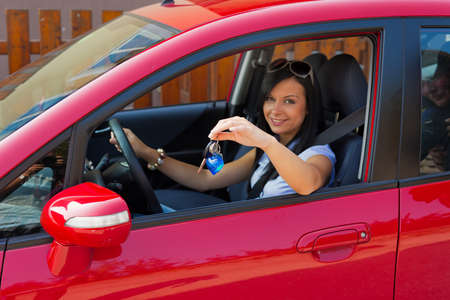 young woman with a new car and car keys photo