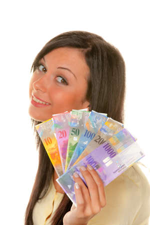 franc: young woman holding swiss francs in hand