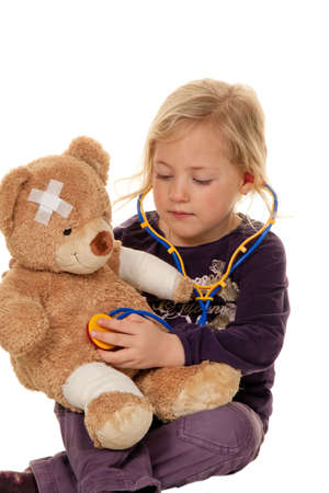 practical: child with a stethoscope as a medical doctor. pediatrician examined patients