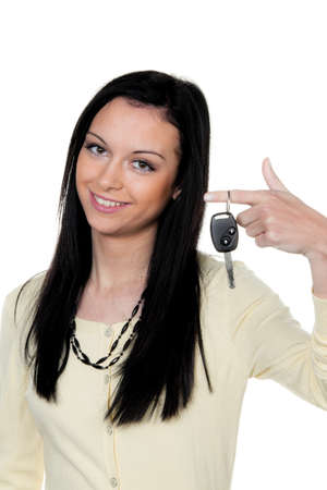 driving school: woman with car keys after driving test