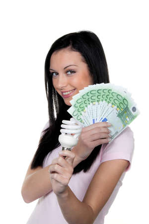 ordinance: woman with energy-saving lamp. lamp energy and money € Stock Photo