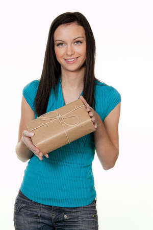 send parcel: woman with a package delivery service. before white hijntergrund