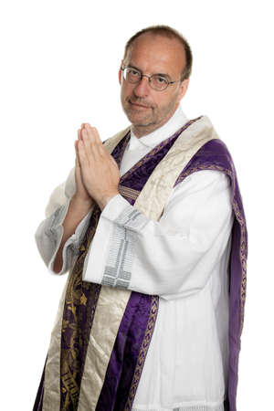 catholic priest: a catholic priest, while praying in church Stock Photo