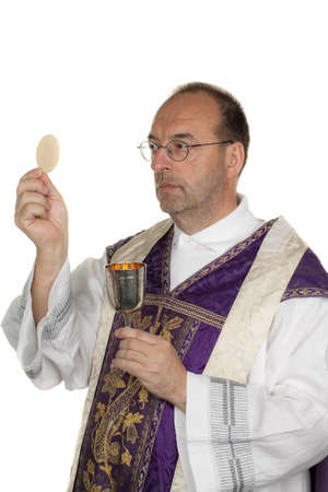 a catholic priest during communion in worship photo
