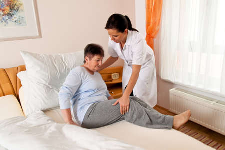 a nurse in elderly care for the elderly in nursing homes Stock Photo - 12080062