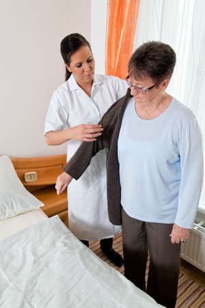 a nurse in elderly care for the elderly in nursing homes Stock Photo - 12080071