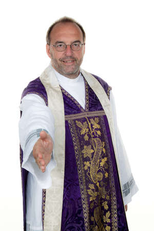 extends: a catholic priest extends his hand in greeting. Stock Photo