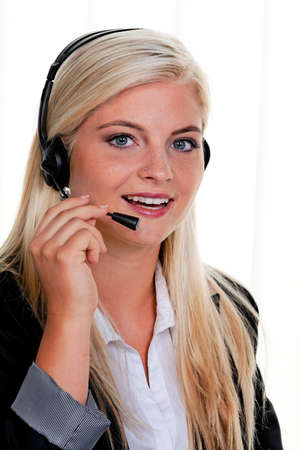 young woman with telephone headset in a call center Stock Photo