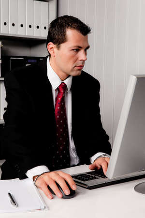 freelancers: young businessman in office with computer desk Stock Photo