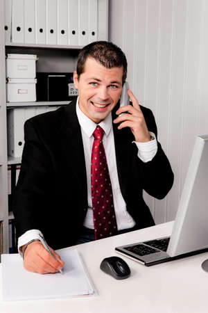 freelancers: young businessman in office with a desk telephone