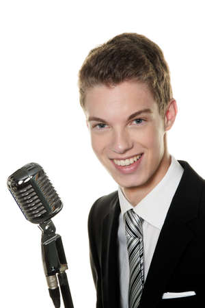 peoplesoft: a young singer with retro mic sing karaoke