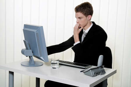 a man has problems with computer viruses and spam in the office Stock Photo - 12080653