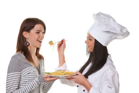 tried: young chef tried her home-cooked pasta dish from Stock Photo