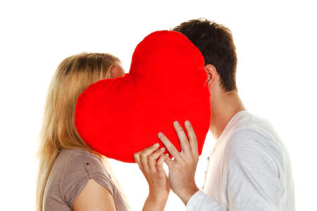 couple in love kissing behind a heart. love is beautiful. secret love photo