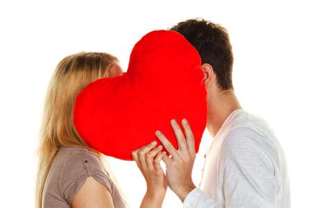 secret love: couple in love kissing behind a heart. love is beautiful. secret love