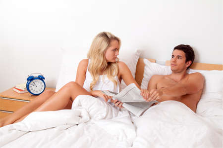 a young couple in bed has problems and crisis. divorce and separation. photo