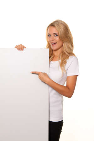 woman with empty poster to advertise the opening and offers photo