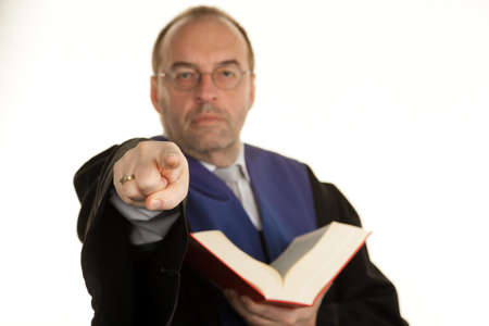 a judge with a law book in court. book in hand. photo