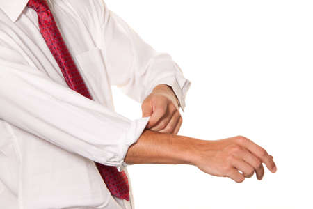 assured: successful, strong and powerful tackle. roll up your shirt sleeves. mens shirt. Stock Photo