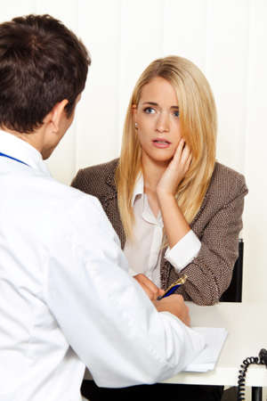 a diagnosis: medical consultation. patient and doctor talking to a doctors office