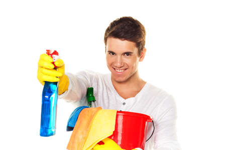 man with cleaning fluid. cleaning the apartment. hausmannbei apartment cleaning in the spring photo