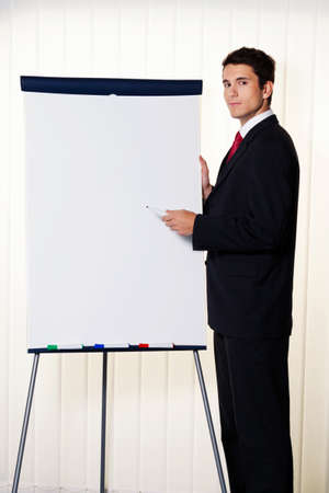 successful business man with a flip chart in a presentation photo