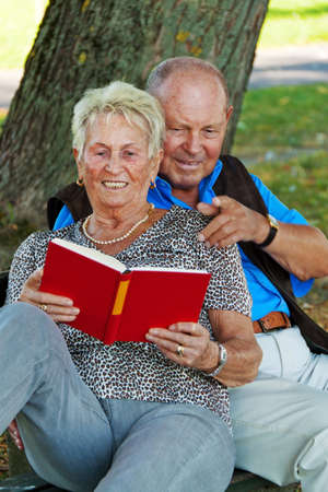 mature senior couple in love. read a book photo