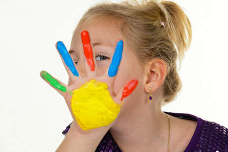 art processing: a child painting with finger paints. funny and creative. Stock Photo