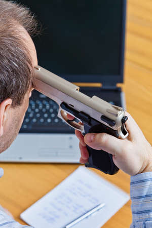 a farewell letter and the gun of a suicide. photo