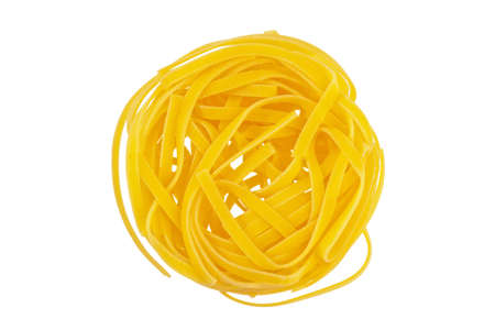 semolina pasta: uncooked pasta nests are adjacent. tagliatelle from italy. Stock Photo