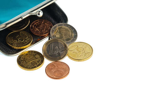 subsistence: an empty wallet with a few euro coins. photo icon on debt and poverty