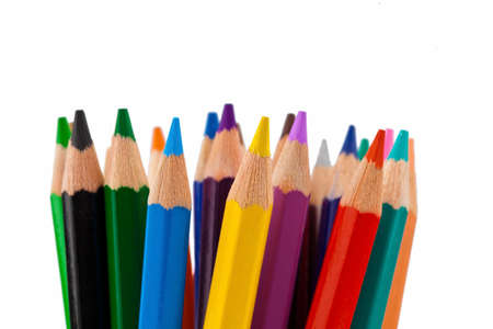 stationery needs: crayons many different colors in a glass. Stock Photo