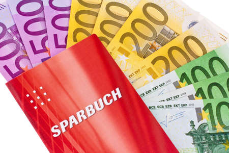many euro banknotes and savings accounts. against a white background photo