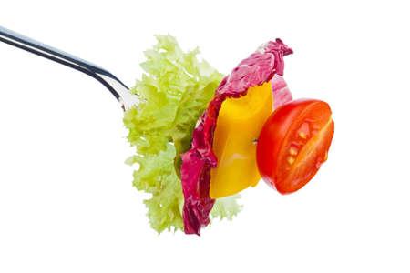 Salat und Gem�se auf einer Gabel. gesunde Ern�hrung mit Bio-Lebensmitteln Lizenzfreie Bilder