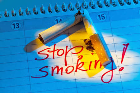 intent: giving up smoking  good resolution in the calendar to be non smoking  Stock Photo