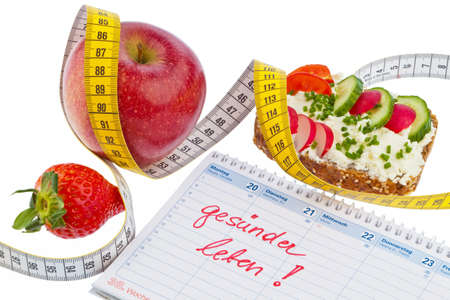 intent: apple, tape measure, bread with vegetables and a calendar  good resolution for healthy diet