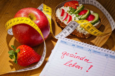 ecologically: apple, tape measure, bread with vegetables and a calendar  good resolution for healthy diet