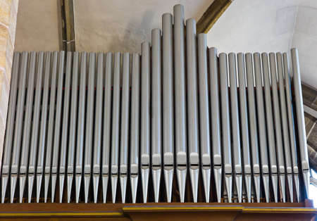 section of an organ in a church  organ pipes are next to each other  photo